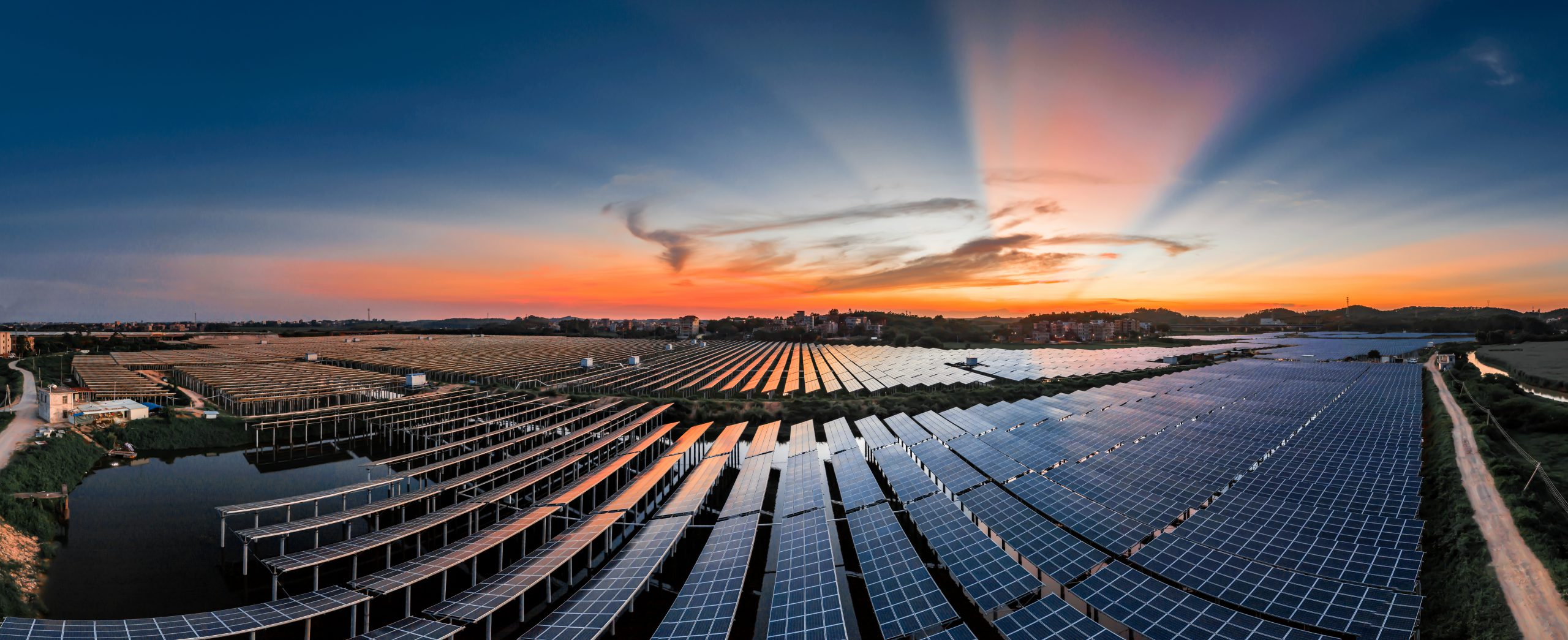 A solar power plant in a beautiful sunset